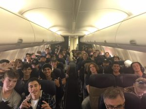 Varsity football players on plane to Seattle