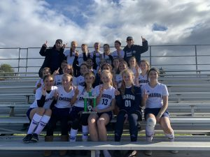 Girls JV Soccer holding first place trophy